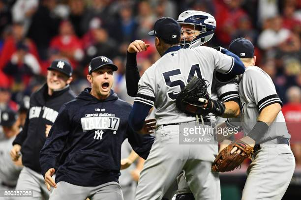 Aroldis Chapman of the New York Yankees celebrates with teammates after their 5 to 2 win over the Cleveland Indians in Game Five of the American...