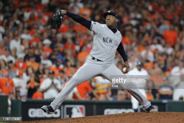 Aroldis Chapman of the New York Yankees delivers the pitch against the Houston Astros during the ninth inning in game six of the American League...
