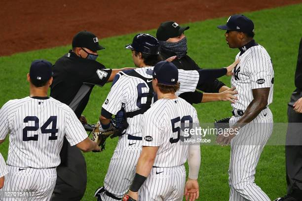 Aroldis Chapman of the New York Yankees exchanges words with the Tampa Bay Rays after the final out in the ninth inning at Yankee Stadium on...