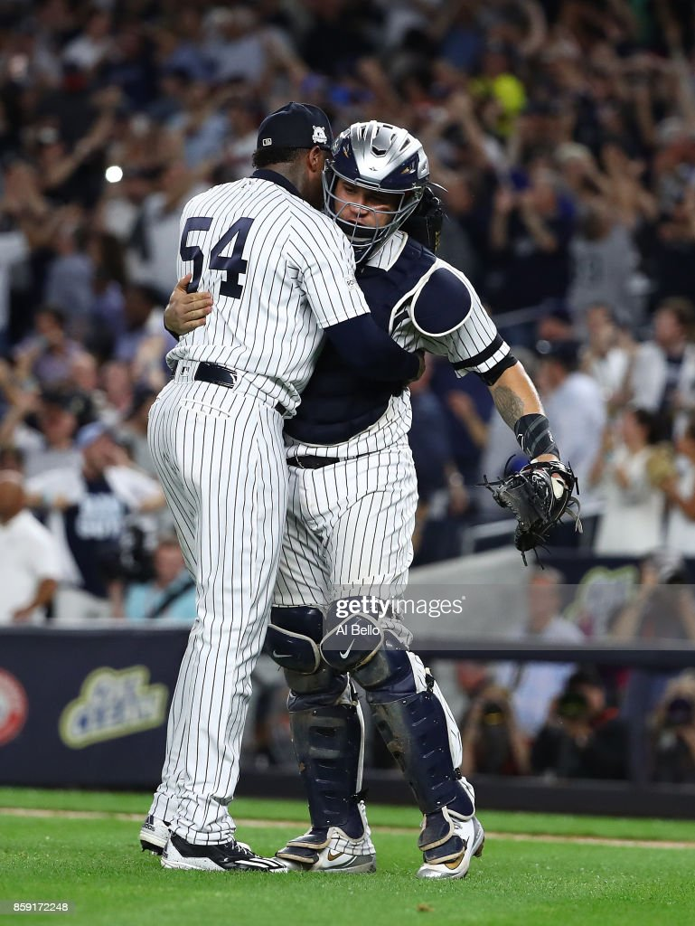 Aroldis Chapman #54 of the New York Yankees gets the save and celebrates a 1-0 win against the Cleveland Indians with Gary Sanchez #24 of the New York Yankees during Game Three of the American League Divisional Series at Yankee Stadium on October 8, 2017 in New York City.
