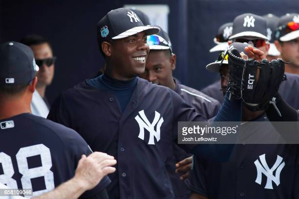 Aroldis Chapman of the New York Yankees is congratulated by his teammates after outing during the spring training game between the Tampa Bay Rays and...