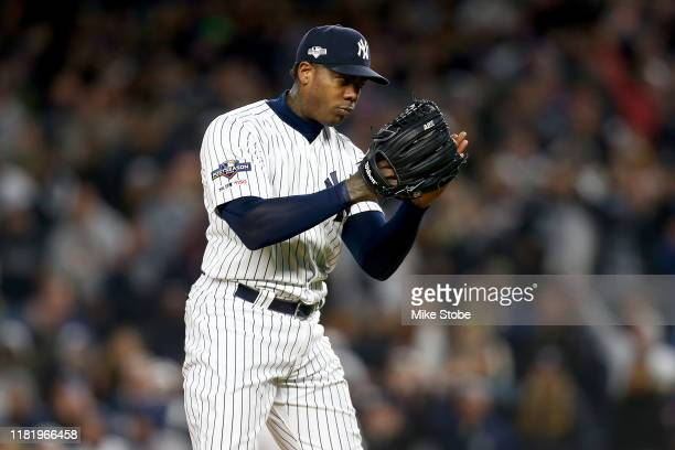 Aroldis Chapman of the New York Yankees looks on against the Houston Astros during the ninth inning in game five of the American League Championship...