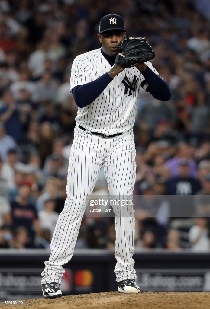 Aroldis Chapman #54 of the New York Yankees prepares to deliver a pitch during the eighth inning against the Cleveland Indiansin game three of the American League Division Series at Yankee Stadium on October 8, 2017 in New York City.