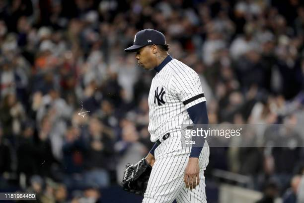 Aroldis Chapman of the New York Yankees reacts after defeating the Houston Astros in game five of the American League Championship Series with a...