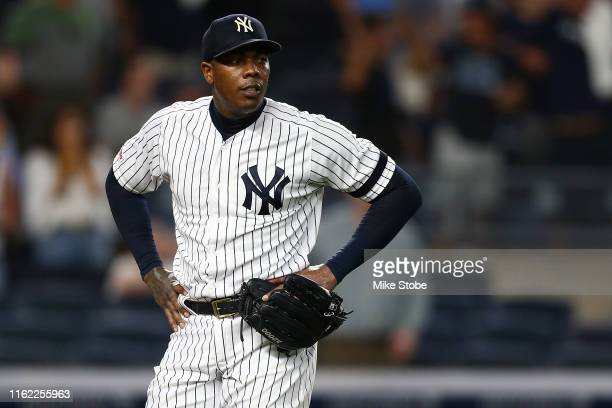 Aroldis Chapman of the New York Yankees reacts after giving up a three-run home run to Travis d'Arnaud of the Tampa Bay Rays in the ninth inning at...