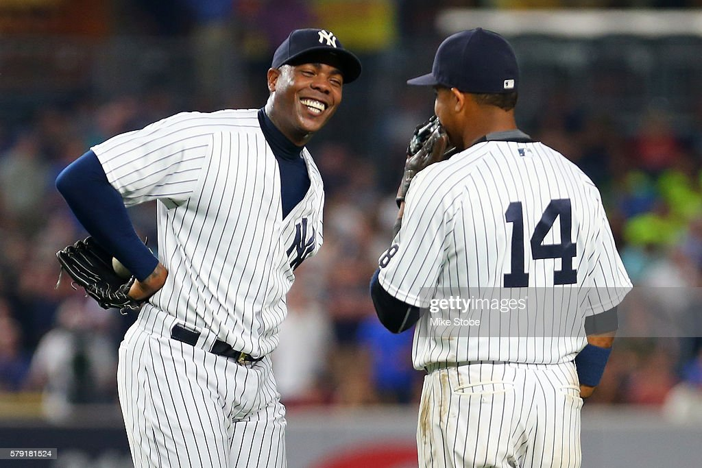 Aroldis Chapman #54 of the New York Yankees shares a laugh with Starlin Castro #14 during the ninth inning against the San Francisco Giants at Yankee Stadium on July 22, 2016 in the Bronx borough of New York City.