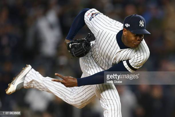 Aroldis Chapman of the New York Yankees throws a pitch against the Houston Astros during the ninth inning in game five of the American League...