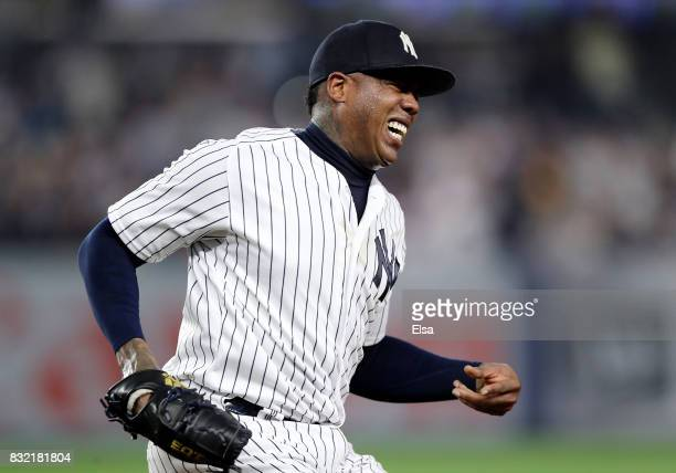 Aroldis Chapman of the New York Yankees winces in pain as he make the final out at first base in the ninth inning against the New York Mets during...