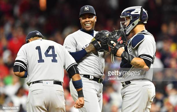 Aroldis Chapman Starlin Castro and Gary Sanchez of the New York Yankees celebrate in the ninth inning against the Cleveland Indians in Game Five of...