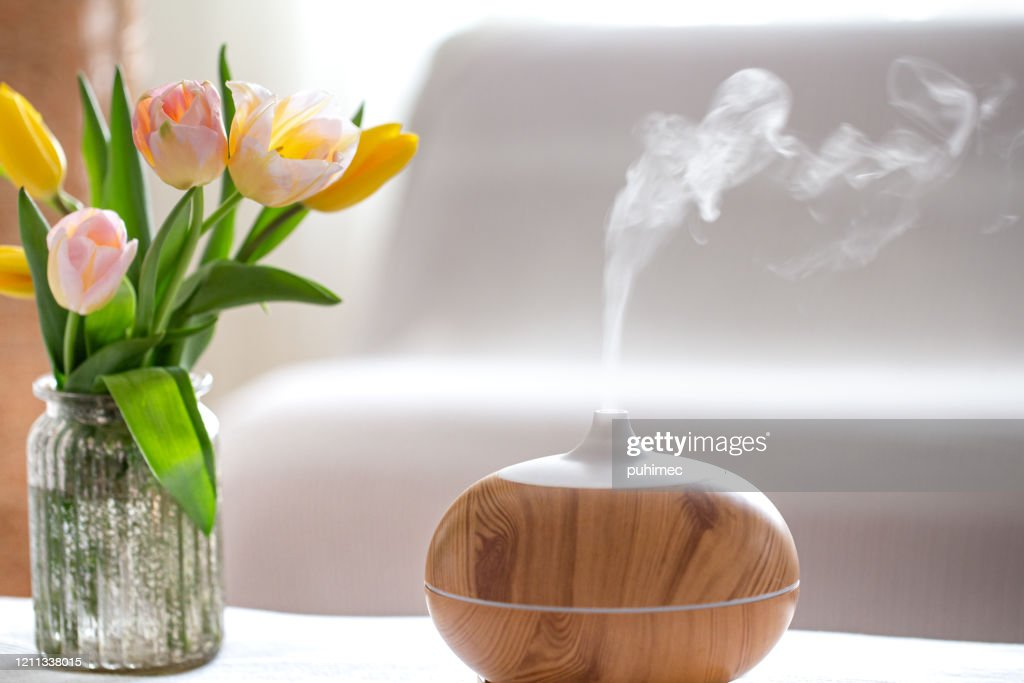 Aroma oil diffuser lamp on the table . : Stock Photo