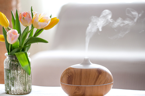 Aroma oil diffuser lamp on the table . 1211338015