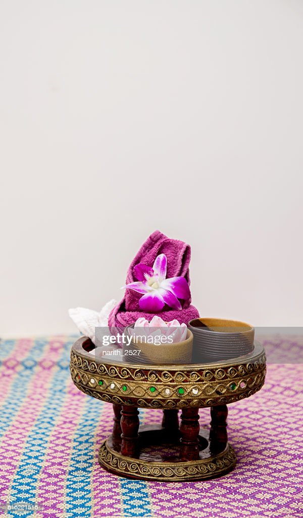 Aroma oil, facial cream, powder, towel on table : Stock Photo