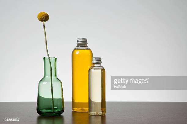 Aromatherapy oil and a vase with a Billybutton Daisy (Craspedia)