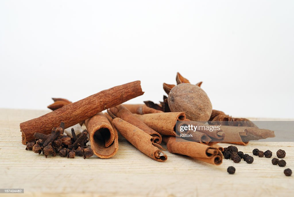 Aromatic Spices on a Wooden Cutting Board with a White Background : Stock Photo