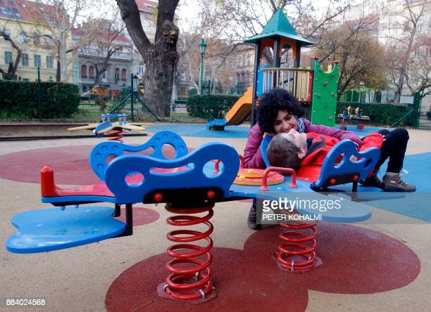 Aron and his mother Eszter Harsanyi are pictured at a local playground in Budapest on November 22 2017 Shrieks of laughter by nondisabled and...