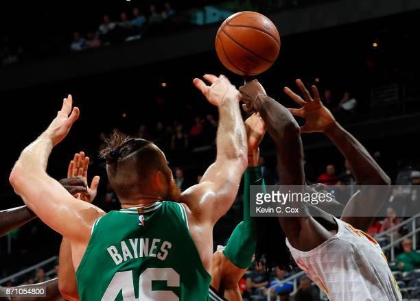 Aron Baynes and Jayson Tatum of the Boston Celtics battle for a rebound against Taurean Prince of the Atlanta Hawks at Philips Arena on November 6...
