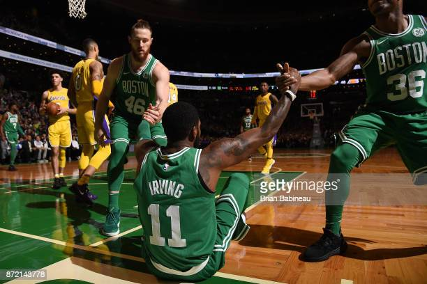 Aron Baynes and Marcus Smart help up Kyrie Irving of the Boston Celtics duriing the game against the Los Angeles Lakers on November 8 2017 at the TD...