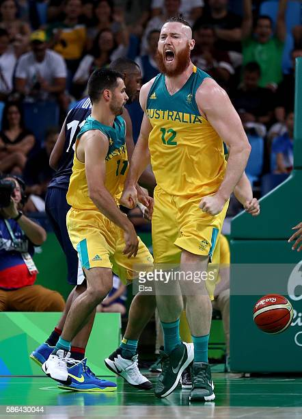 Aron Baynes of Australia celebrate with teammate Kevin Lisch in the first half against France on Day 1 of the Rio 2016 Olympic Games at Carioca Arena...