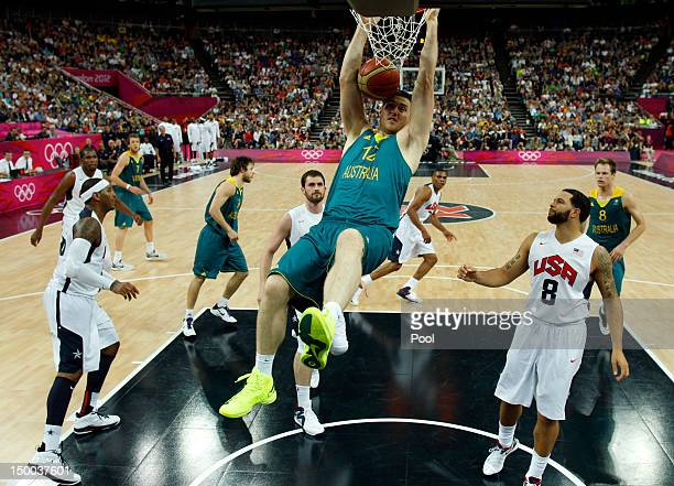Aron Baynes of Australia dunks against the United States during the Men's Basketball quaterfinal game on Day 12 of the London 2012 Olympic Games at...