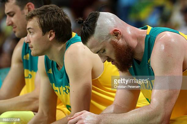 Aron Baynes of Australia looks on from the bench during the Men's Basketball Bronze medal game between Australia and Spain on Day 16 of the Rio 2016...