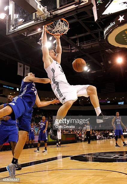 Aron Baynes of the Austin Toros dunks over Steve Weingarten of the Delaware 87ers on December 1 2013 at the Cedar Park Center in Cedar Park Texas...