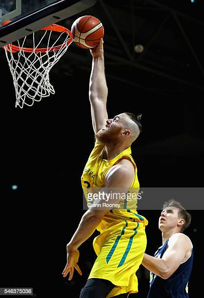 Aron Baynes of the Boomers dunks the ball during the match between the Australian Boomers and the Pac-12 College All-Stars at Hisense Arena on July...