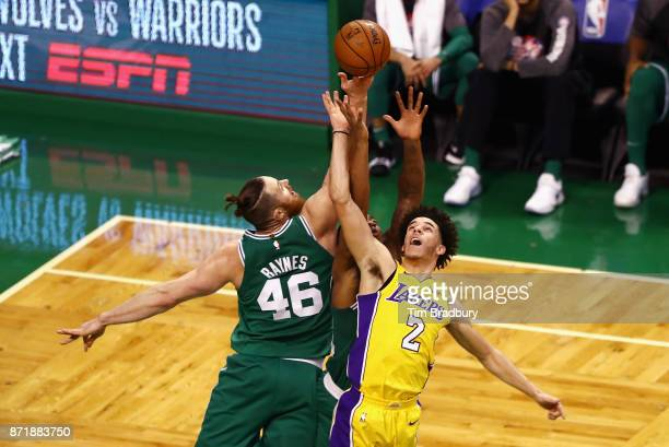Aron Baynes of the Boston Celtics and Lonzo Ball of the Los Angeles Lakers battle for the ball during the fourth quarter at TD Garden on November 8...