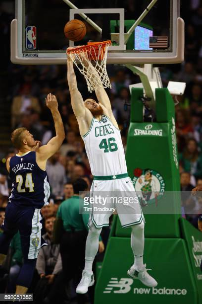 Aron Baynes of the Boston Celtics attempts to dunk the ball during the first half against the Denver Nuggets at TD Garden on December 13 2017 in...