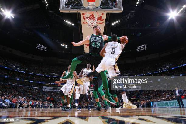 Aron Baynes of the Boston Celtics blocks the shot against the New Orleans Pelicans on March 18 2018 at Smoothie King Center in New Orleans Louisiana...