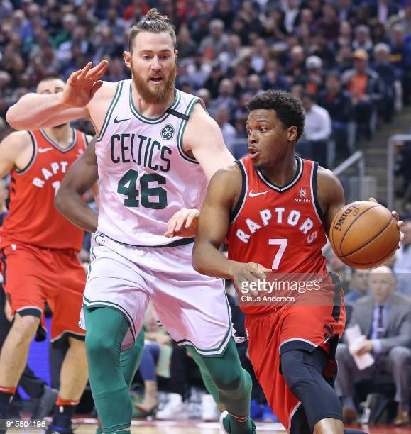 Aron Baynes of the Boston Celtics defends against a driving Kyle Lowry of the Toronto Raptors in an NBA game at the Air Canada Centre on February 6...
