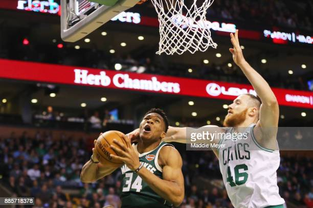Aron Baynes of the Boston Celtics defends Giannis Antetokounmpo of the Milwaukee Bucks during the first quarter at TD Garden on December 4 2017 in...