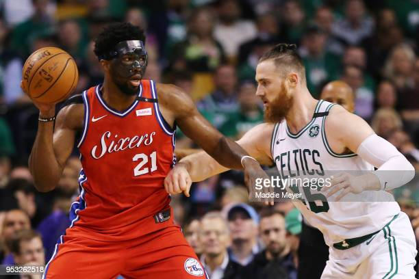 Aron Baynes of the Boston Celtics defends Joel Embiid of the Philadelphia 76ers during the second half of Game One in Round Two of the 2018 NBA...