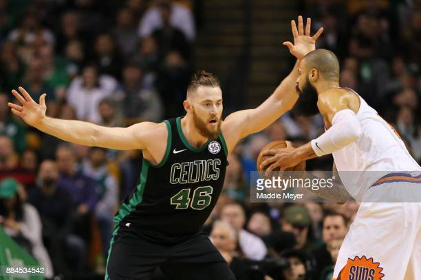 Aron Baynes of the Boston Celtics defends Tyson Chandler of the Phoenix Suns during the first half at TD Garden on December 2 2017 in Boston...