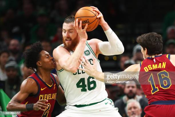 Aron Baynes of the Boston Celtics drives to the basket while guarded by Collin Sexton of the Cleveland Cavaliers during a game at TD Garden on...