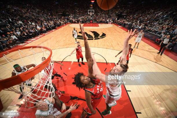 Aron Baynes of the Boston Celtics dunks against Lucas Nogueira of the Toronto Raptors on February 6 2018 at the Air Canada Centre in Toronto Ontario...