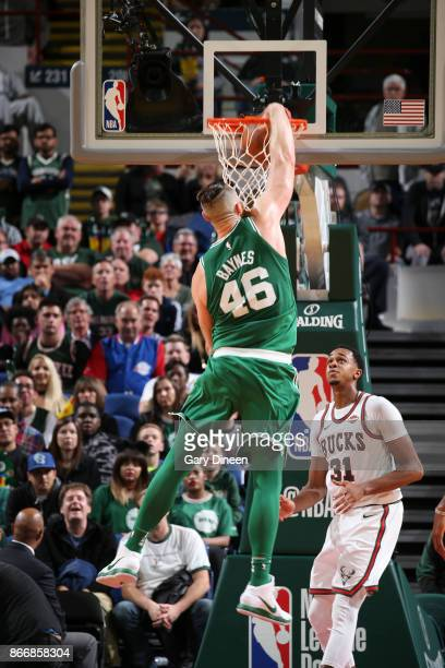 Aron Baynes of the Boston Celtics dunks the ball against the Milwaukee Bucks on October 26 2017 at the UWMilwaukee Panther Arena in Milwaukee...