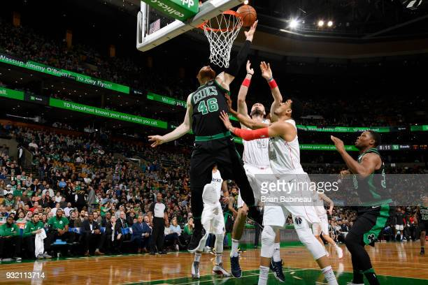 Aron Baynes of the Boston Celtics goes to the basket against the Washington Wizards on March 14 2018 at the TD Garden in Boston Massachusetts NOTE TO...