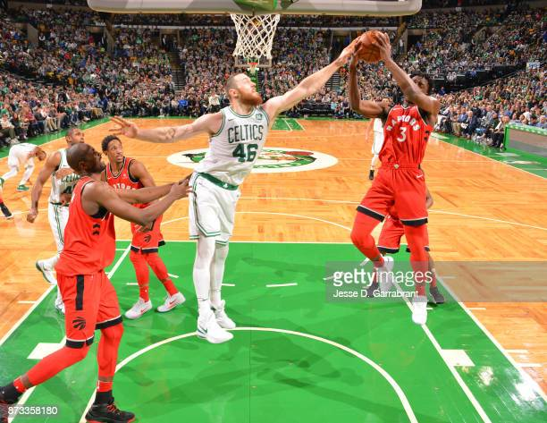 Aron Baynes of the Boston Celtics goes up for the block shot during the game against the Toronto Raptors on November 12 2017 at the TD Garden in...
