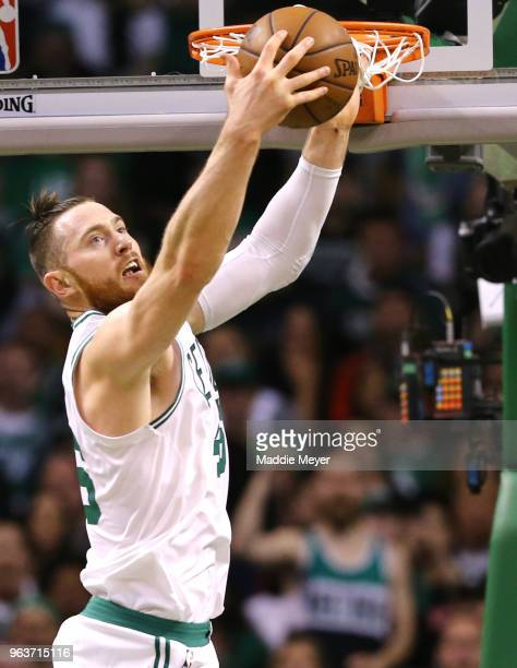 Aron Baynes of the Boston Celtics grabs a rebound during Game Seven of the 2018 NBA Eastern Conference Finals at TD Garden on May 27 2018 in Boston...