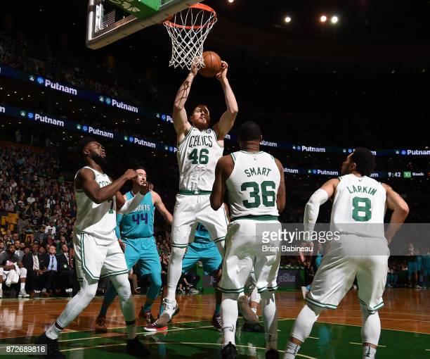 Aron Baynes of the Boston Celtics grabs the rebound against the Charlotte Hornets on November 10 2017 at the TD Garden in Boston Massachusetts NOTE...