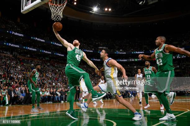 Aron Baynes of the Boston Celtics grabs the rebound against the Golden State Warriors on November 16 2017 at the TD Garden in Boston Massachusetts...