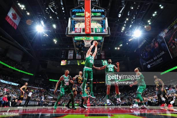 Aron Baynes of the Boston Celtics grabs the rebound against the Atlanta Hawks on November 18 2017 at Philips Arena in Atlanta Georgia NOTE TO USER...