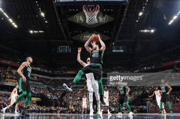 Aron Baynes of the Boston Celtics grabs the rebound against the Indiana Pacers on November 25 2017 at Bankers Life Fieldhouse in Indianapolis Indiana...