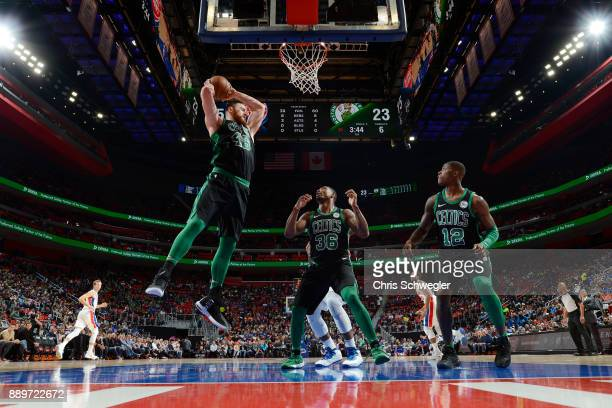 Aron Baynes of the Boston Celtics grabs the rebound against the Detroit Pistons on December 10 2017 at Little Caesars Arena in Detroit Michigan NOTE...