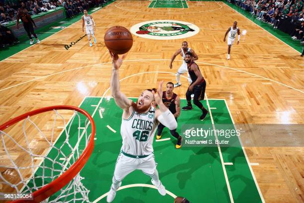 Aron Baynes of the Boston Celtics grabs the rebound against the Cleveland Cavaliers during Game Seven of the Eastern Conference Finals of the 2018...
