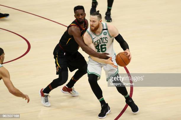 Aron Baynes of the Boston Celtics handles the ball against Jeff Green of the Cleveland Cavaliers in the third quarter during Game Six of the 2018 NBA...