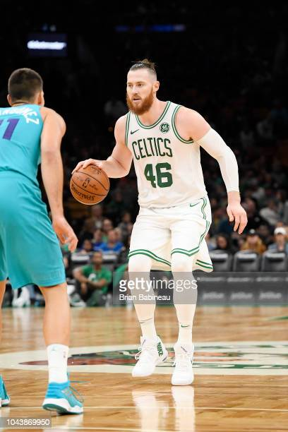 Aron Baynes of the Boston Celtics handles the ball against the Charlotte Hornets during a preseason game on September 30 2018 at the TD Garden in...