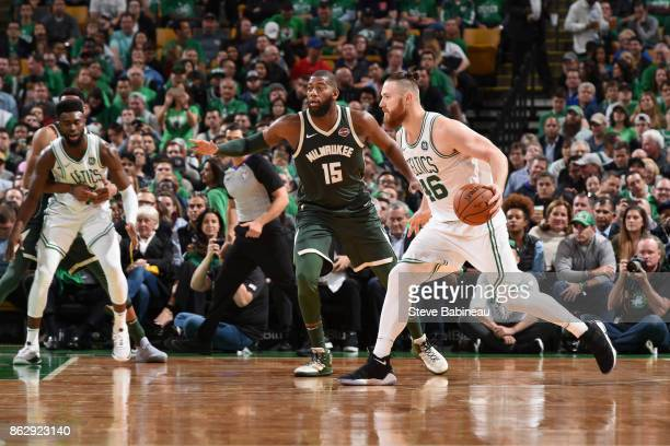 Aron Baynes of the Boston Celtics handles the ball against the Milwaukee Bucks on October 18 2017 at the TD Garden in Boston Massachusetts NOTE TO...