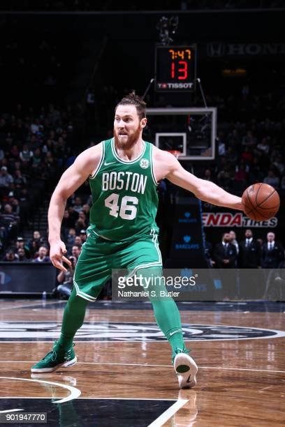 Aron Baynes of the Boston Celtics handles the ball against the Brooklyn Nets on January 6 2018 at Barclays Center in Brooklyn New York NOTE TO USER...