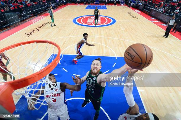 Aron Baynes of the Boston Celtics handles the ball against the Detroit Pistons on December 10 2017 at Little Caesars Arena in Detroit Michigan NOTE...